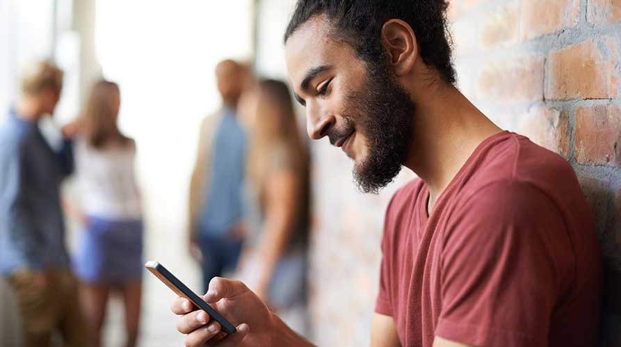 Tertiary-student-uses-his-phone-for-online-tutoring.jpg