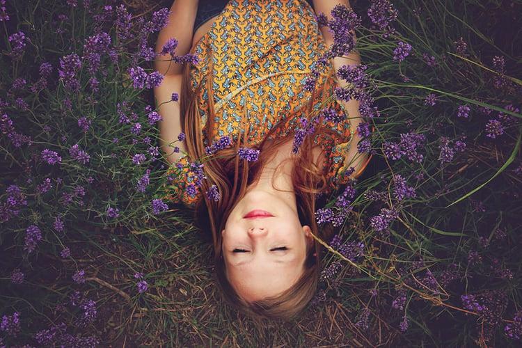 Girl-in-flowers-field.jpg